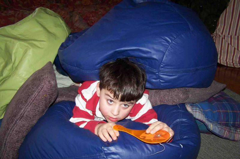 William enjoys the gentle pressure of bean bags and cushions